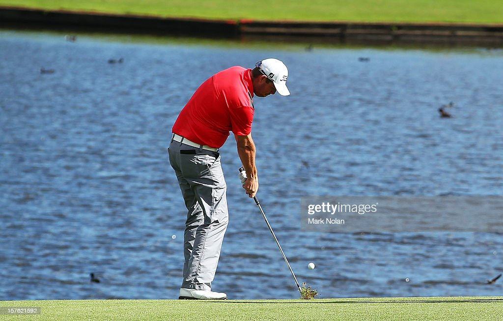 <a gi-track='captionPersonalityLinkClicked' href=/galleries/search?phrase=Marc+Leishman&family=editorial&specificpeople=2582046 ng-click='$event.stopPropagation()'>Marc Leishman</a> of Australia plays over the water during the Pro-Am ahead of the 2012 Australian Open, beginning tomorrow, at The Lakes Golf Club on December 5, 2012 in Sydney, Australia.