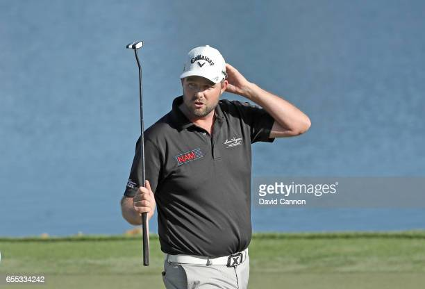 Marc Leishman of Australia raises his putter on te 18th green after his one shot victory in the final round of the 2017 Arnold Palmer Invitational...