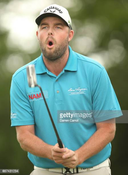 Marc Leishman of Australia reacts after missing a putt on the 1st hole of his playoff during round three of the World Golf ChampionshipsDell...