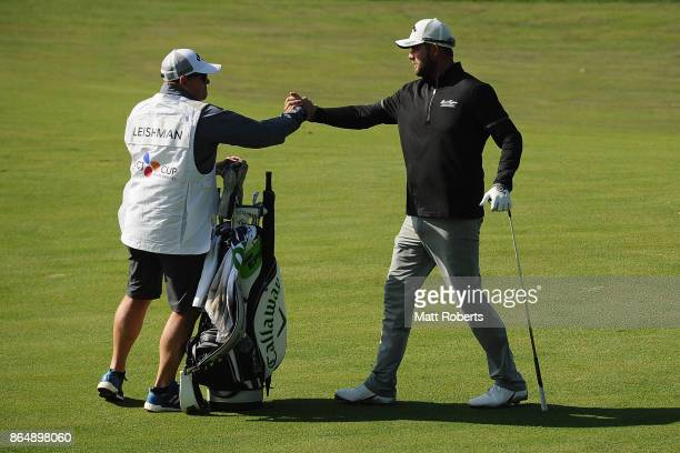 Marc Leishman of Australia reacts with his caddie during the final round of the CJ Cup at Nine Bridges on October 22 2017 in Jeju South Korea