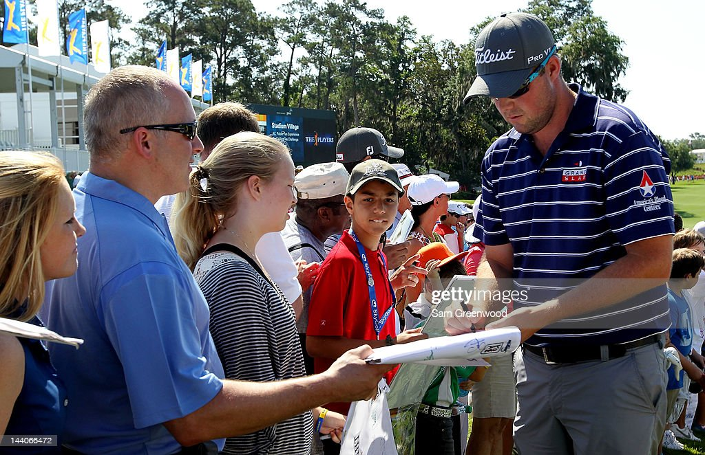 <a gi-track='captionPersonalityLinkClicked' href=/galleries/search?phrase=Marc+Leishman&family=editorial&specificpeople=2582046 ng-click='$event.stopPropagation()'>Marc Leishman</a> of Australia signs his autograph for fans during a practice round prior to the start of THE PLAYERS Championship held at THE PLAYERS Stadium course at TPC Sawgrass on May 9, 2012 in Ponte Vedra Beach, Florida.