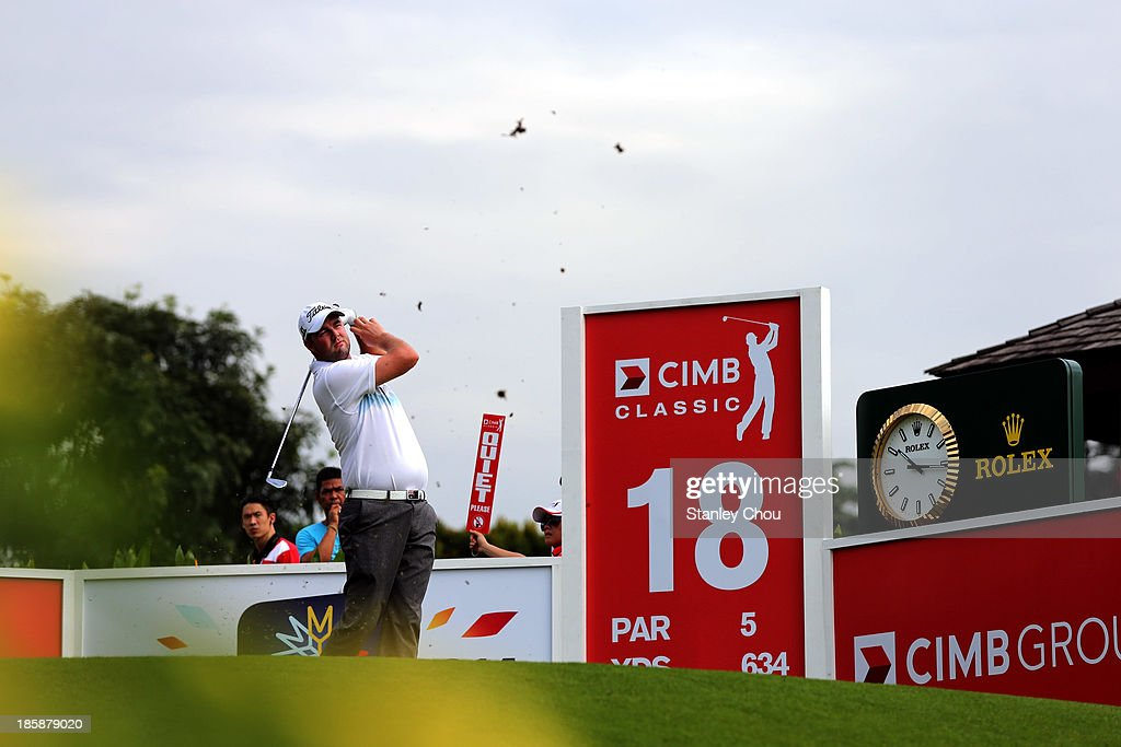 Marc Leishman of Australia tees off on the 18th hole during round two of the CIMB Classic at Kuala Lumpur Golf & Country Club on October 25, 2013 in Kuala Lumpur, Malaysia.