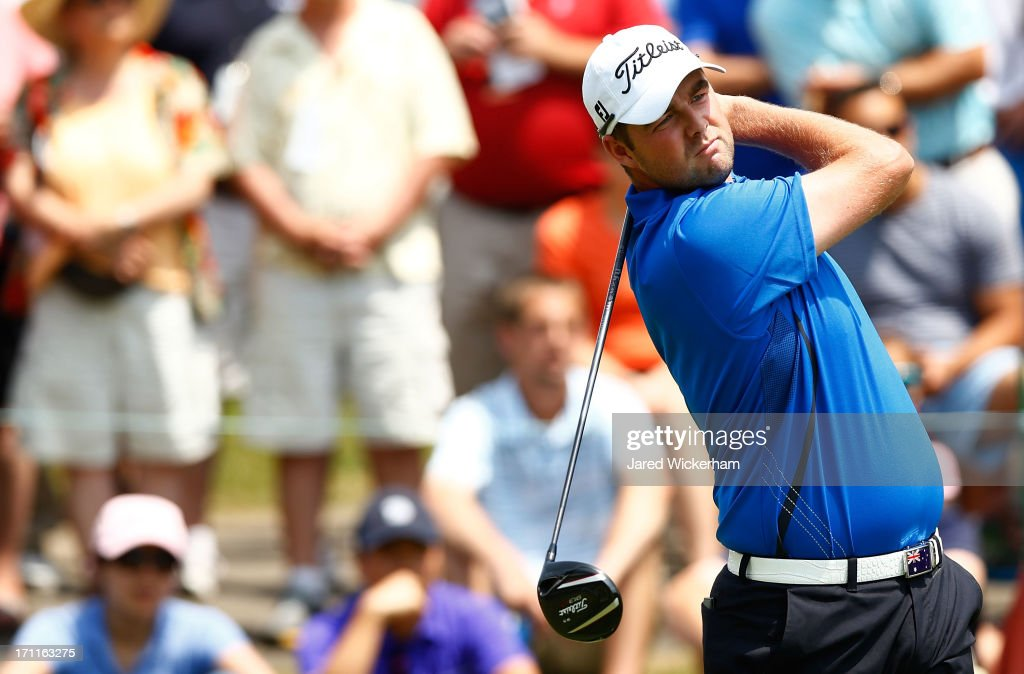 <a gi-track='captionPersonalityLinkClicked' href=/galleries/search?phrase=Marc+Leishman&family=editorial&specificpeople=2582046 ng-click='$event.stopPropagation()'>Marc Leishman</a> of Australia tees off on the 1st hole during the third round of the 2013 Travelers Championship at TPC River Highlands on June 22, 2012 in Cromwell, Connecticut.