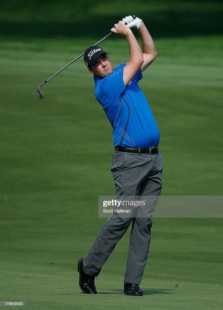 <a gi-track='captionPersonalityLinkClicked' href=/galleries/search?phrase=Marc+Leishman&family=editorial&specificpeople=2582046 ng-click='$event.stopPropagation()'>Marc Leishman</a> of Australia watches a shot during a practice round prior to the start of the 95th PGA Championship at Oak Hill Country Club on August 5, 2013 in Rochester, New York.