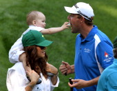 Marc Leishman of Australia with his wife Audrey and son Harvey during the Par 3 Contest held the day before the start of the 77th Masters golf...