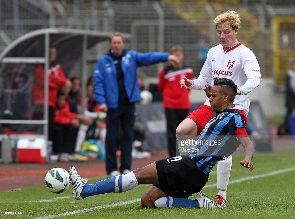 Marc Lerandy of Saarbruecken (R) challenges Michael Preuss of Halle (L) during the Third League match between 1. FC Saarbruecken and Hallescher FC at Ludwigsparkstadion on November 24, 2012 in Saarbruecken, Germany.
