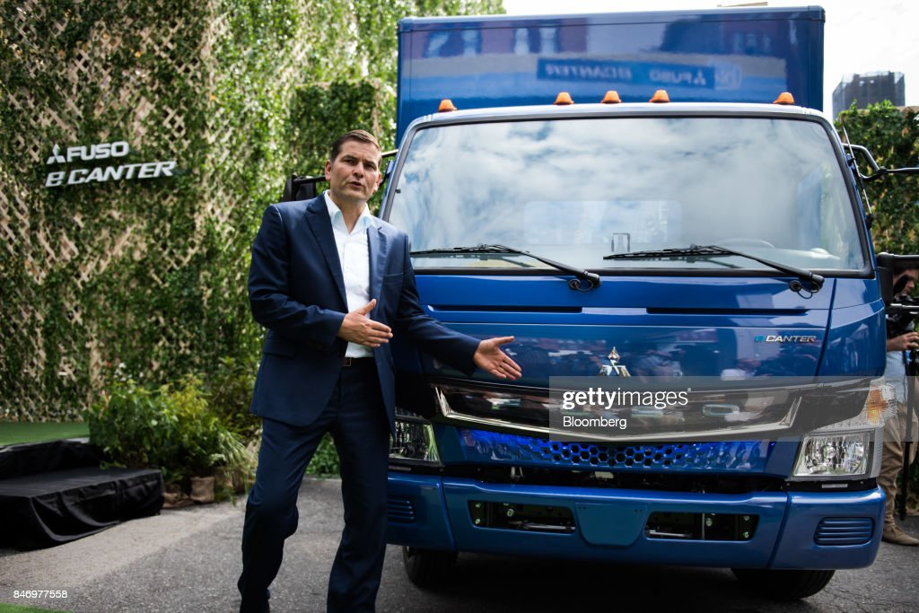 Marc Llistosella, chief executive officer of MitsubishiFusoTruck and Bus Corp., speaks while standing next to the eCanter truck during a launch event in New York, U.S., on Thursday, Sept. 14, 2017. The Daimler AG unit unveiled the new Fuso eCanter, an electric light-duty truck produced under its Mitsubishi Fuso brand. The latest version has a range of 60 to 80 miles (97 to 129 kilometers) between charges, depending on body, load and usage. Photographer: Mark Kauzlarich/Bloomberg via Getty Images