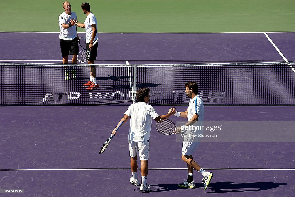 Marc Lopez and Marcel Granollers of Spain celebrate their win against Marin Cilic of Croatia and Lukas Dlouhy of Czech Republic during the Sony Open...