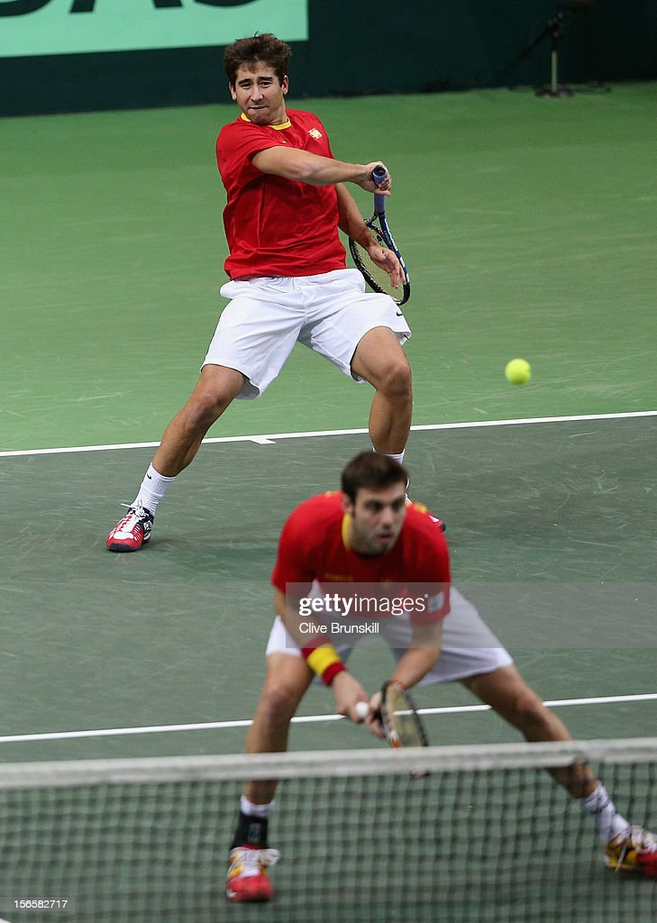 Marc Lopez and Marcel Granollers of Spain in action during their doubles match against Radek Stepanek and Tomas Berdych of Czech Republic during day two of the final Davis Cup match between Czech Republic and Spain at the 02 Arena on November 17, 2012 in Prague, Czech Republic.
