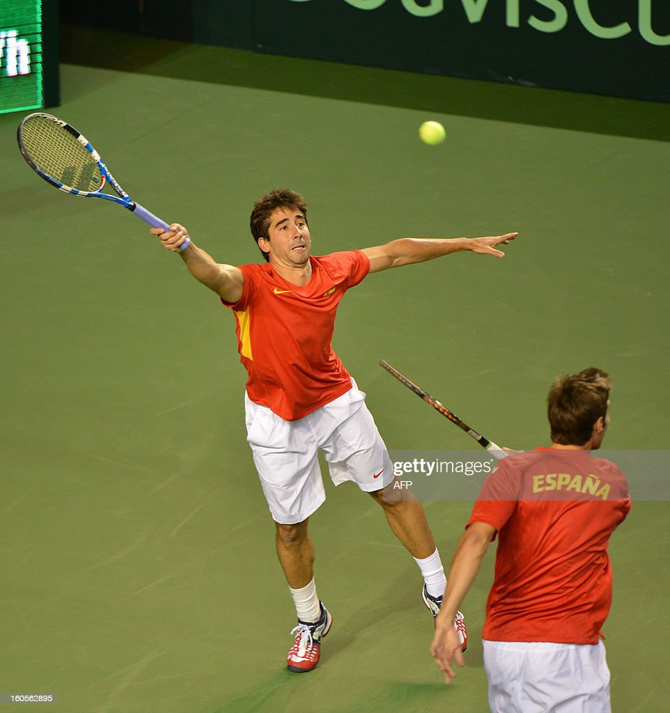 Marc Lopez (L) and Marcel Granollers of Spain play against Daniel Nestor and Vasek Pospisil of Canada during a Davis Cup World Group Doubles Rubber, February 2, 2013, at the Doug Mitchell Thunderbird Sports Centre, in Vancouver, BC. AFP PHOTO / Don MACKINNON