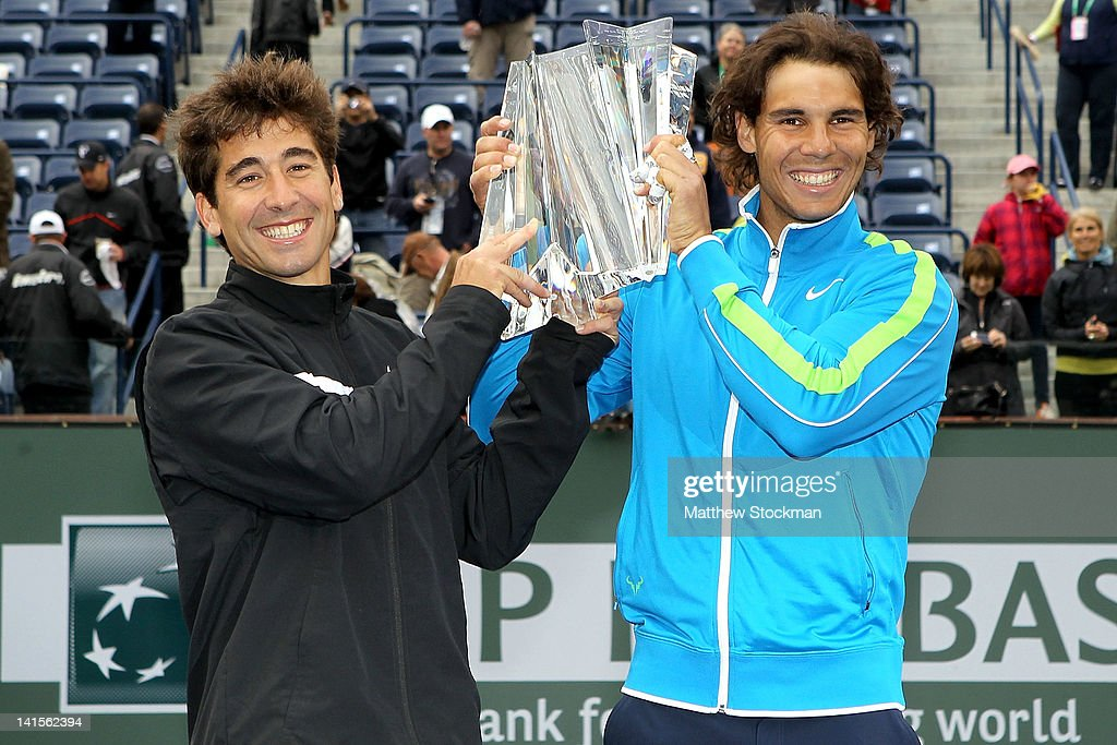 Marc Lopez and <a gi-track='captionPersonalityLinkClicked' href=/galleries/search?phrase=Rafael+Nadal&family=editorial&specificpeople=194996 ng-click='$event.stopPropagation()'>Rafael Nadal</a> of Spain pose for photographers after defeating Sam Querrey and John Isner during the doubles final of the BNP Paribas Open at the Indian Wells Tennis Garden on March 18, 2012 in Indian Wells, California.