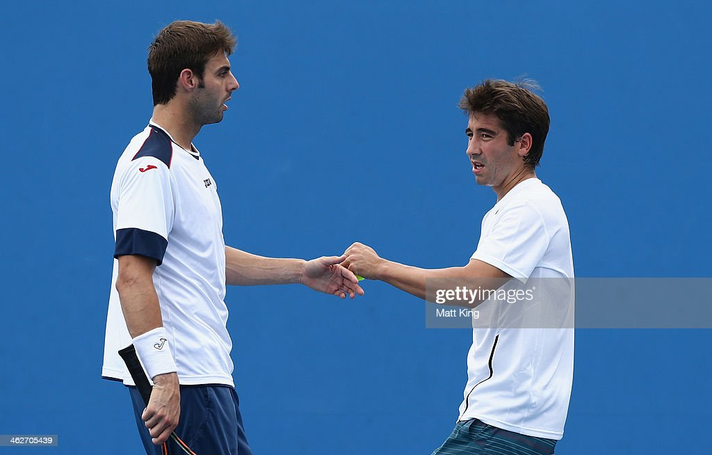 <a gi-track='captionPersonalityLinkClicked' href=/galleries/search?phrase=Marc+Lopez&family=editorial&specificpeople=2564593 ng-click='$event.stopPropagation()'>Marc Lopez</a> of Spain and Marcel Granollers of Spain talk tactics in their first round doubles match against Samuel Groth of Australia John-Patrick Smith of Australia during day three of the 2014 Australian Open at Melbourne Park on January 15, 2014 in Melbourne, Australia.