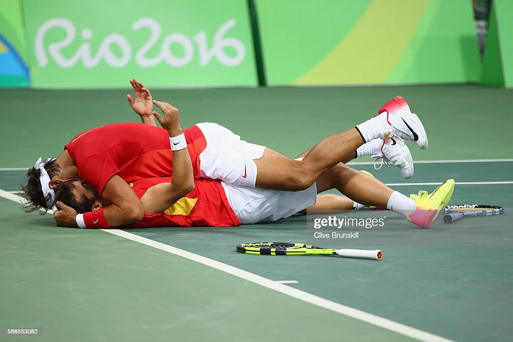 Marc Lopez of Spain and Rafael Nadal of Spain celebrate victory in their men's doubles semifinal against Daniel Nestor of Canada and Vasek Pospisil of Canada on Day 6 of the 2016 Rio Olympics at the Olympic Tennis Centre on August 11, 2016 in Rio de Janeiro, Brazil.