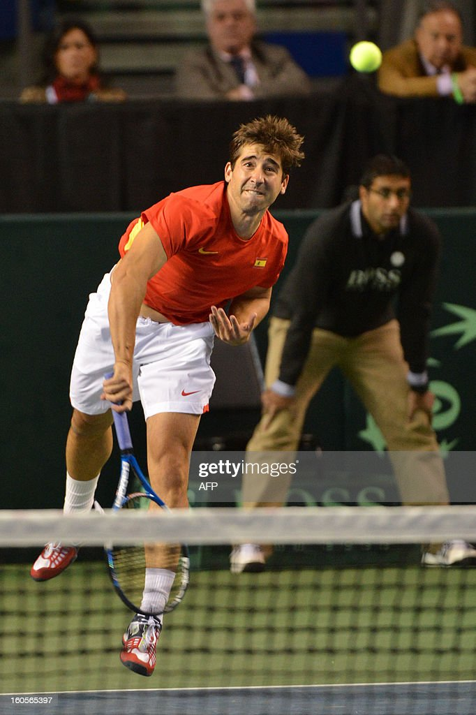 Marc Lopez of Spain and teammate Marcel Granollers (not pictured) play against Daniel Nestor and Vasek Pospisil (both not pictured) of Canada during a Davis Cup World Group Doubles Rubber, February 2, 2013, at the Doug Mitchell Thunderbird Sports Centre, in Vancouver, BC. AFP PHOTO / Don MACKINNON