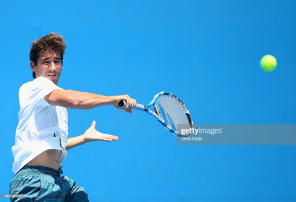 <a gi-track='captionPersonalityLinkClicked' href=/galleries/search?phrase=Marc+Lopez&family=editorial&specificpeople=2564593 ng-click='$event.stopPropagation()'>Marc Lopez</a> of Spain plays a forehand in his second round doubles match with Marcel Granollers of Spain against Max Mirnyi of Belarus and Mikhail Youzhny of Russia during day five of the 2014 Australian Open at Melbourne Park on January 17, 2014 in Melbourne, Australia.