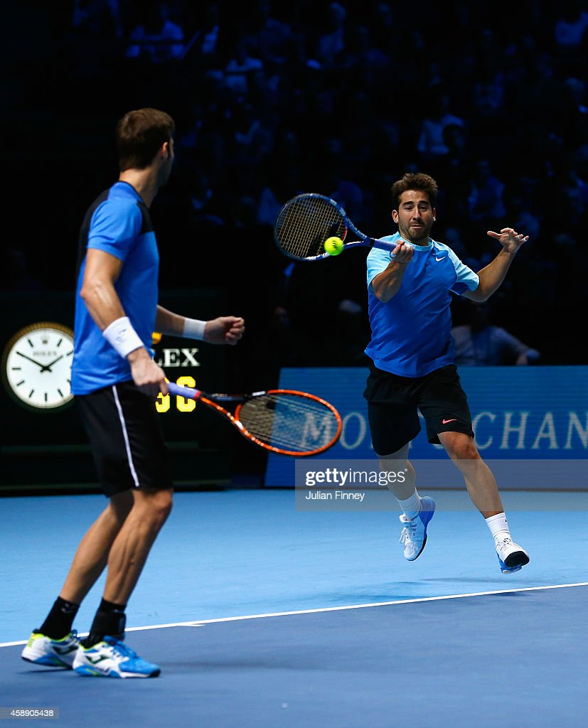 Marc Lopez of Spain plays a forehand in the round robin doubles match with Marcel Granollers of Spain against Daniel Nestor of Canada and Nenad Zimonjic of Serbia on day five of the Barclays ATP World Tour Finals at O2 Arena on November 13, 2014 in London, England.