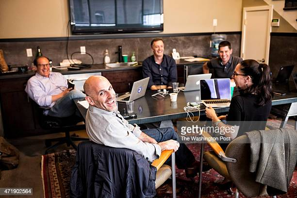 Marc Lore CEO of new ecommerce site jetcom and his team smile at the photographer during the meeting in the conference room at jetcom headquarter on...