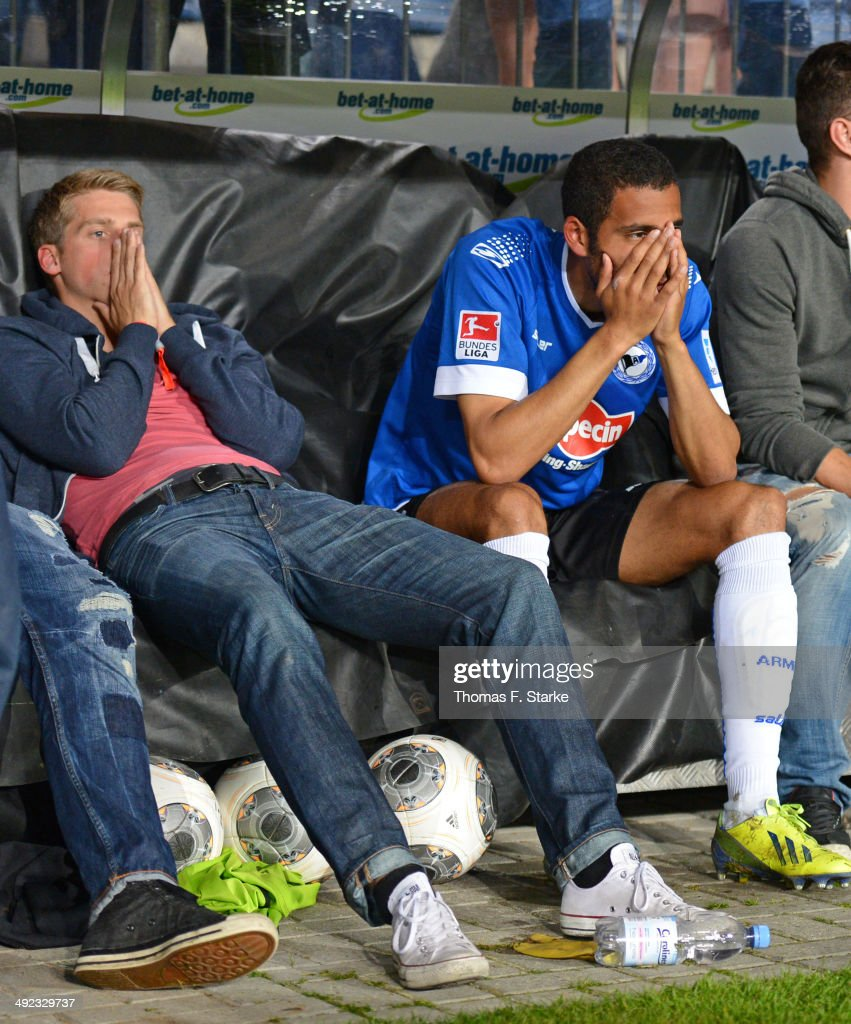 Marc Lorenz (L) and Marcel Appiah of Bielefeld look dejected after loosing the Second Bundesliga Playoff Second Leg match between Arminia Bielefeld and Darmstadt 98 at Schueco Arena on May 19, 2014 in Bielefeld, Germany.