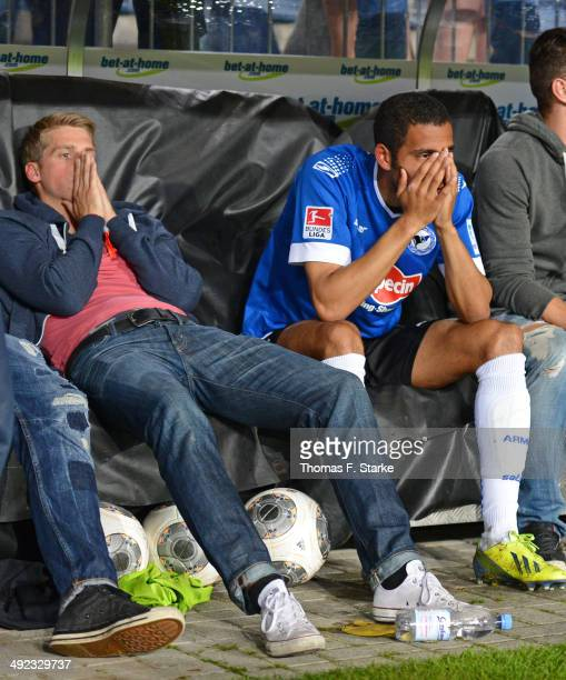 Marc Lorenz and Marcel Appiah of Bielefeld look dejected after loosing the Second Bundesliga Playoff Second Leg match between Arminia Bielefeld and...
