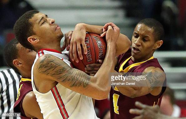 Marc Loving of the Ohio State Buckeyes battles for control of the ball with DeAndre Mathieu of the Minnesota Golden Gophers during the second round...