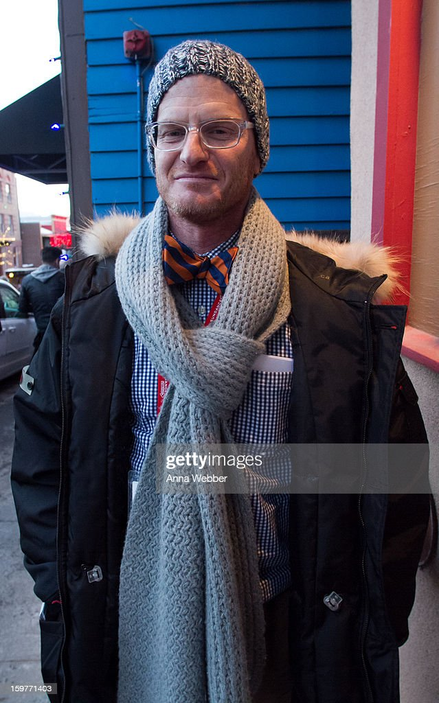 Marc Malkin, writer for E! News and E! Online from Los Angeles, wearing Roca Wear feather down jacket, J. Press bowtie, J. Crew thermal, Allsaints skinny jeans, brown leather Ugg boots and Salt glasses on January 19, 2013 on the streets of Park City, Utah.