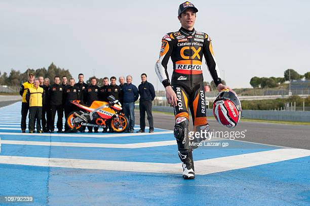 Marc Marquez of Spain and Catalunya Caixa Repsol poses with the team during the second day of Moto2 And 125cc IRTA tests at Circuito de Jerez on...