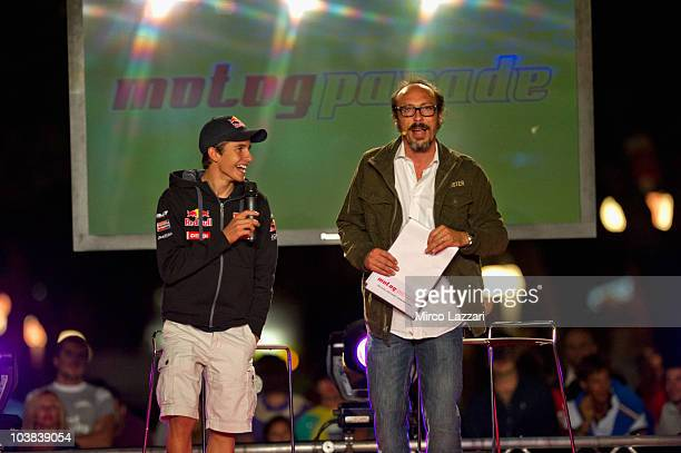 Marc Marquez of Spain and Red Bull AJo Motorsport speaks with the italian journalist Guido Meda and during the preevent MotoGP Riders Parade ahead of...