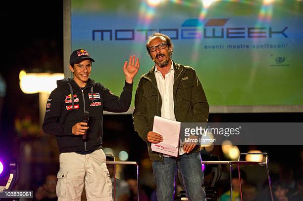 Marc Marquez of Spain and Red Bull AJo Motorsport speaks with the italian journalist Guido Meda and greets the fans during the preevent MotoGP Riders...