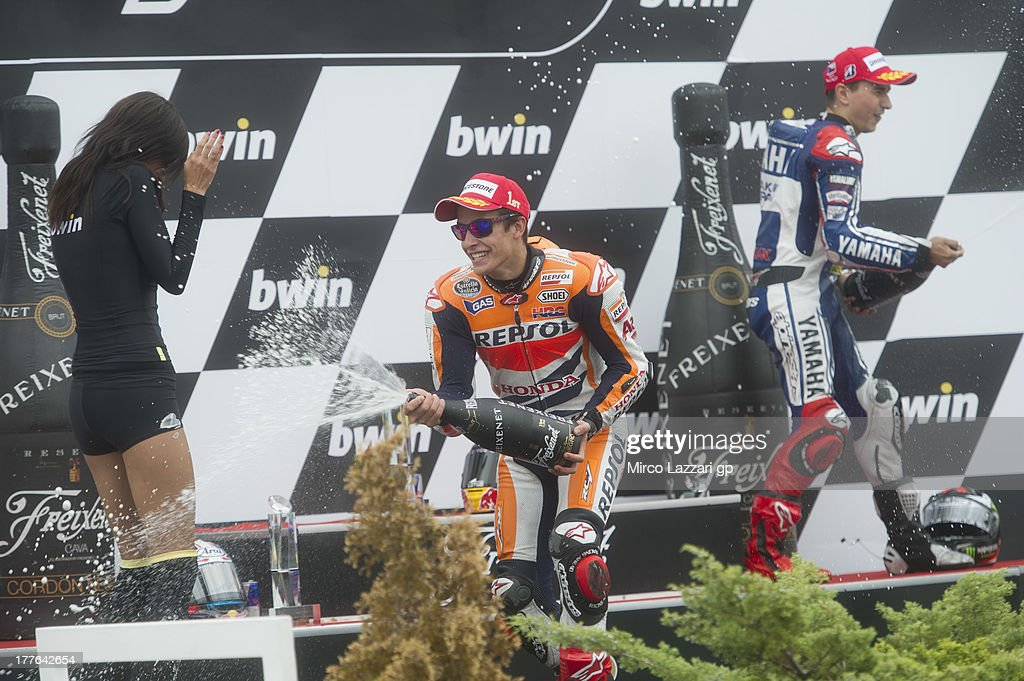 Marc Marquez of Spain and Repsol Honda Team and Jorge Lorenzo of Spain and Yamaha Factory Racing spray champagne on the podium at the end of the MotoGP race during the MotoGp of Czech Republic - Race at Brno Circuit on August 25, 2013 in Brno, Czech Republic.