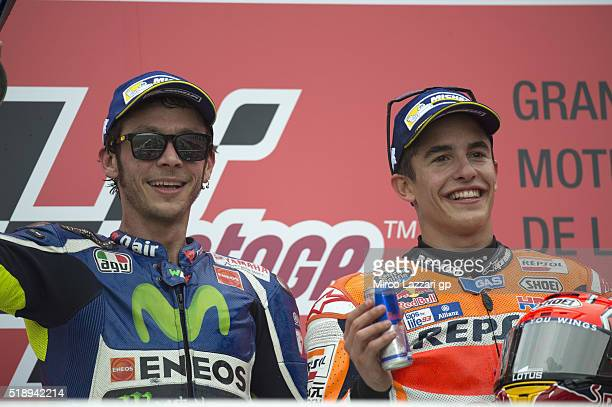 Marc Marquez of Spain and Repsol Honda Team and Valentino Rossi of Italy and Movistar Yamaha MotoGP celebrate on the podium at the end of the MotoGP...
