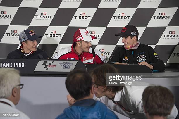 Marc Marquez of Spain and Repsol Honda Team Andrea Dovizioso of Italy and Ducati Team and Alex Marquez of Spain and Estrella Galicia 00 smile during...