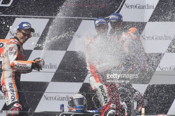 Marc Marquez of Spain and Repsol Honda Team Andrea Dovizioso of Italy and Ducati Team and Dani Pedrosa of Spain and Repsol Honda Team celebrate on...