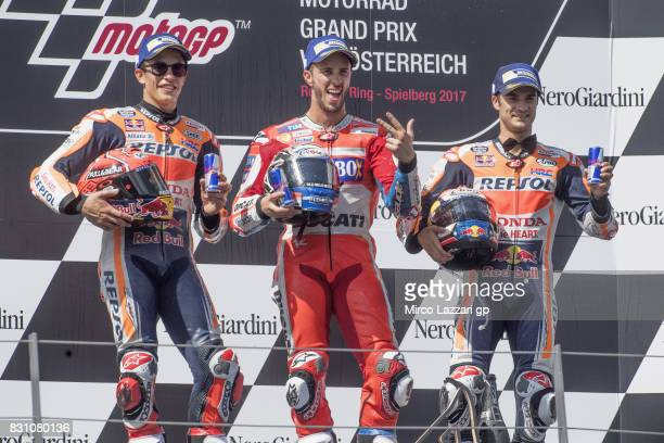 Marc Marquez of Spain and Repsol Honda Team Andrea Dovizioso of Italy and Ducati Team and Dani Pedrosa of Spain and Repsol Honda Team pose on the...