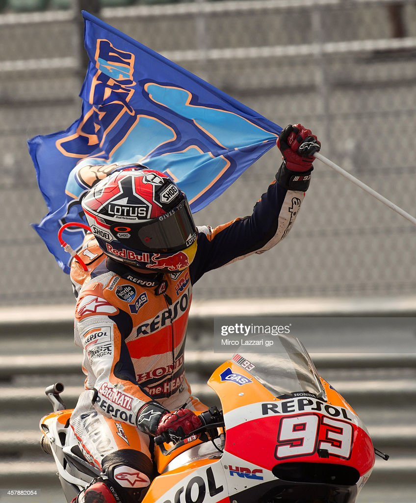 <a gi-track='captionPersonalityLinkClicked' href=/galleries/search?phrase=Marc+Marquez&family=editorial&specificpeople=5409395 ng-click='$event.stopPropagation()'>Marc Marquez</a> of Spain and Repsol Honda Team celebrates after winning the MotoGP Of Malaysia - Race at Sepang Circuit on October 26, 2014 in Kuala Lumpur, Malaysia.