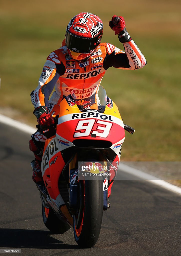 Marc Marquez of Spain and Repsol Honda Team celebrates as he returns to pit lane after winning the 2015 MotoGP of Australia at Phillip Island Grand Prix Circuit on October 18, 2015 in Phillip Island, Australia.