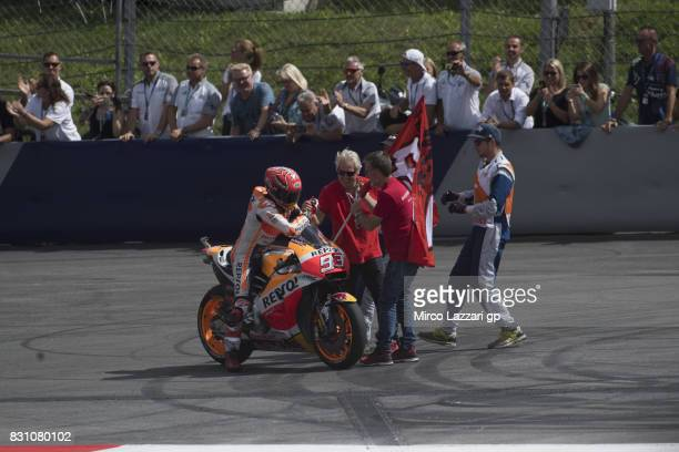 Marc Marquez of Spain and Repsol Honda Team celebrates the second place with the flag at the end of the MotoGP race during the MotoGp of Austria Race...