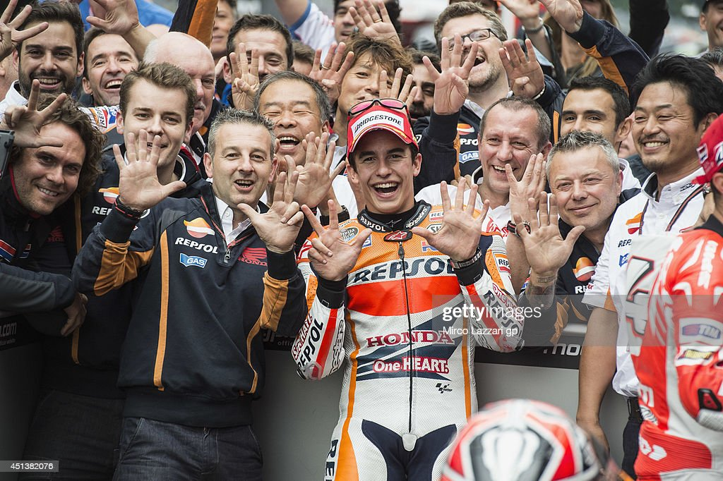 <a gi-track='captionPersonalityLinkClicked' href=/galleries/search?phrase=Marc+Marquez&family=editorial&specificpeople=5409395 ng-click='$event.stopPropagation()'>Marc Marquez</a> of Spain and Repsol Honda Team celebrates the victory under the podium with team at the end of the MotoGp race during the MotoGP of Netherlands - Race at on June 28, 2014 in Assen, Netherlands.