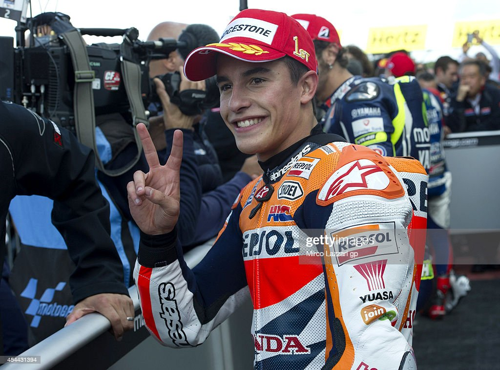 Marc Marquez of Spain and Repsol Honda Team celebrates the victory under the podium at the end of the MotoGP race during the MotoGp Of Great Britain - Race at Silverstone Circuit on August 31, 2014 in Northampton, United Kingdom.