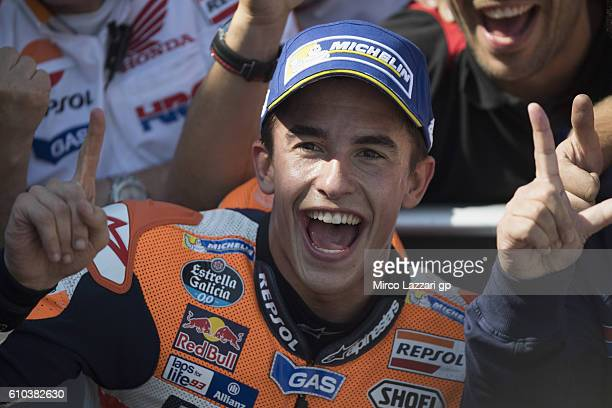 Marc Marquez of Spain and Repsol Honda Team celebrates the victory under the podium at the end of the MotoGP race during the MotoGP of Spain Race at...