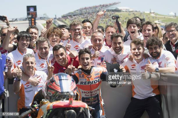 Marc Marquez of Spain and Repsol Honda Team celebrates the victory with team under the podium at the end of the MotoGP race during the MotoGp Red...