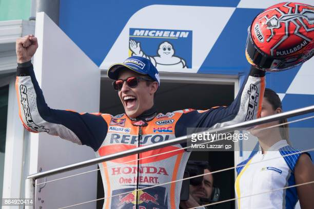 Marc Marquez of Spain and Repsol Honda Team celebrates victory on the podium at the end of the MotoGP race during the 2017 MotoGP of Australia at...