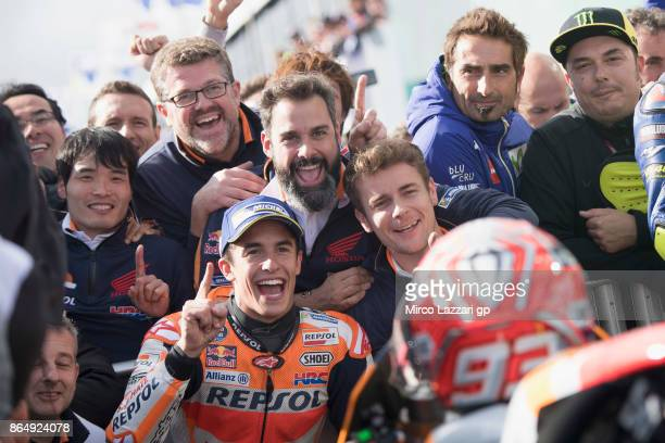 Marc Marquez of Spain and Repsol Honda Team celebrates victory under the podium at the end of the MotoGP race during the 2017 MotoGP of Australia at...