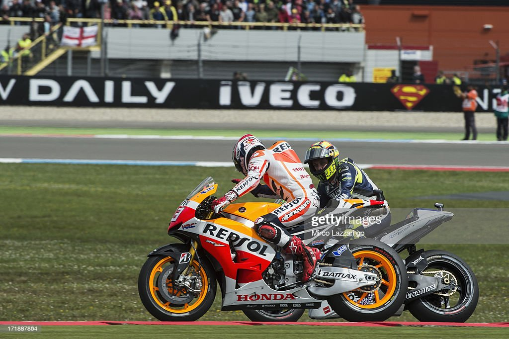 <a gi-track='captionPersonalityLinkClicked' href=/galleries/search?phrase=Marc+Marquez&family=editorial&specificpeople=5409395 ng-click='$event.stopPropagation()'>Marc Marquez</a> of Spain and Repsol Honda Team celebrates with <a gi-track='captionPersonalityLinkClicked' href=/galleries/search?phrase=Cal+Crutchlow&family=editorial&specificpeople=4261131 ng-click='$event.stopPropagation()'>Cal Crutchlow</a> of Great Britain and Monster Yamaha Tech 3 at the end of the MotoGP race during the MotoGp Of Holland - Race at TT Circuit Assen on June 29, 2013 in Assen, Netherlands.