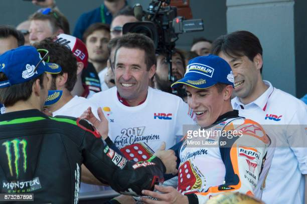Marc Marquez of Spain and Repsol Honda Team celebrates with Johann Zarco of France and Monster Yamaha Tech 3 at the end of the MotoGp race during the...