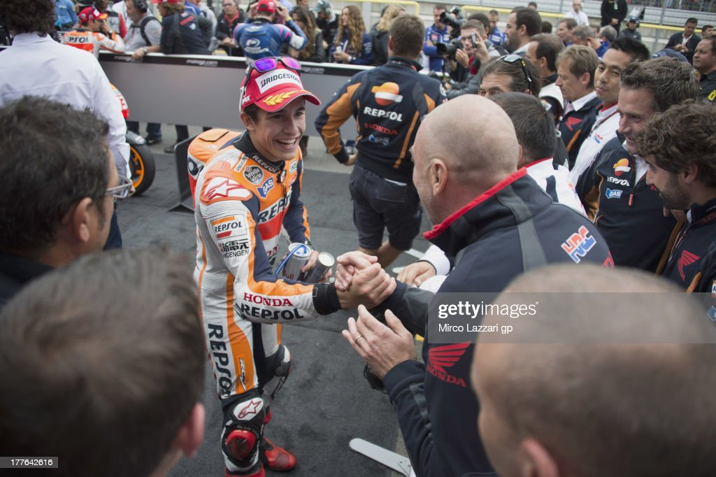 Marc Marquez of Spain and Repsol Honda Team celebrates with team the victory at the end of the MotoGP race during the MotoGp of Czech Republic - Race at Brno Circuit on August 25, 2013 in Brno, Czech Republic.