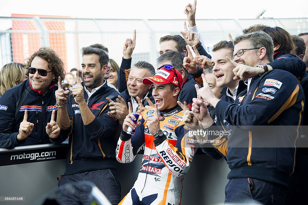 Marc Marquez of Spain and Repsol Honda Team celebrates with team the victory under the podium at the end of the MotoGP race during the MotoGp Of Great Britain - Race at Silverstone Circuit on August 31, 2014 in Northampton, United Kingdom.