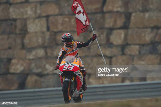 Marc Marquez of Spain and Repsol Honda Team greets the fans at the end of the MotoGP race during the MotoGP of Spain Race at Motorland Aragon Circuit...