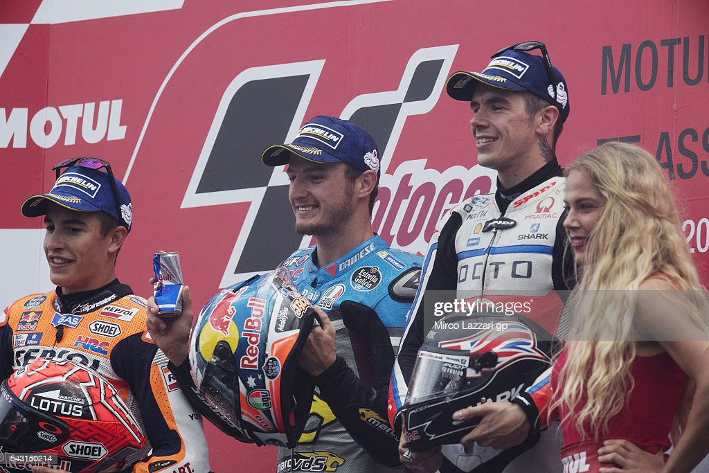 <a gi-track='captionPersonalityLinkClicked' href=/galleries/search?phrase=Marc+Marquez&family=editorial&specificpeople=5409395 ng-click='$event.stopPropagation()'>Marc Marquez</a> of Spain and Repsol Honda Team, <a gi-track='captionPersonalityLinkClicked' href=/galleries/search?phrase=Jack+Miller+-+Motorcycle+Racer&family=editorial&specificpeople=14824906 ng-click='$event.stopPropagation()'>Jack Miller</a> of Australia and Marc VDS Racing Team and Scott Redding of Great Britain and Octo Pramac Racing celebrate on the podium at the end of the MotoGP race during the MotoGP Netherlands - Race at on June 26, 2016 in Assen, Netherlands.