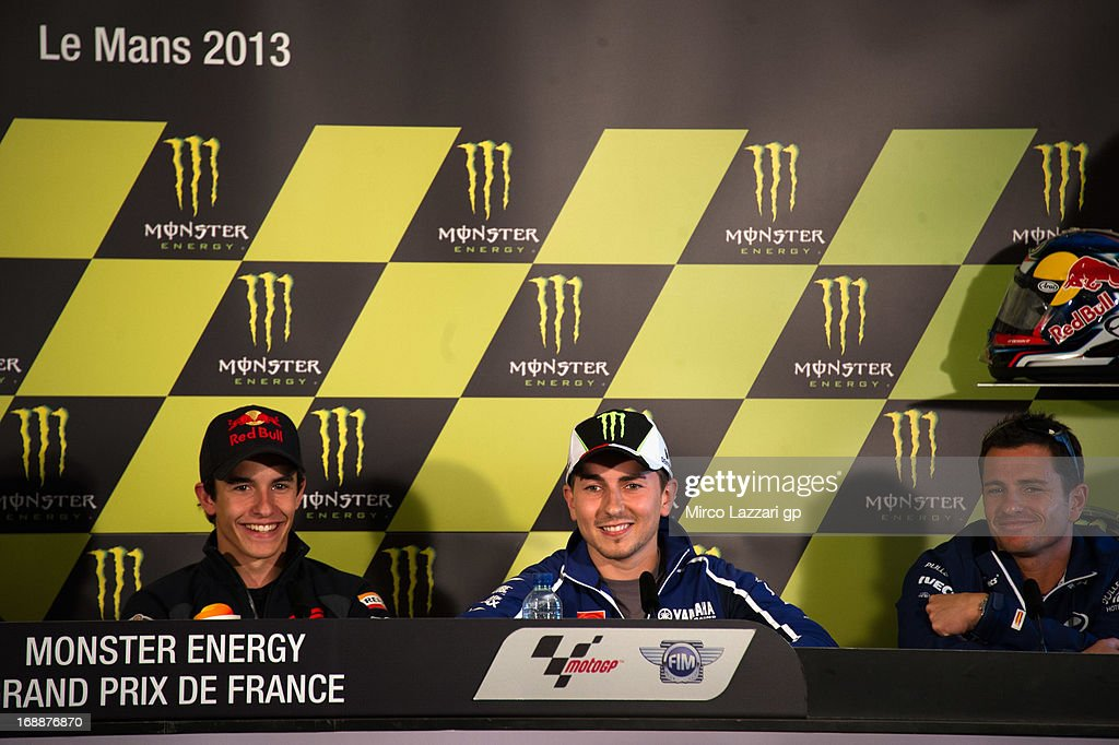 Marc Marquez of Spain and Repsol Honda Team, <a gi-track='captionPersonalityLinkClicked' href=/galleries/search?phrase=Jorge+Lorenzo&family=editorial&specificpeople=543869 ng-click='$event.stopPropagation()'>Jorge Lorenzo</a> of Spain and Yamaha Factory Racing and Randy De Puniet of France and Power Electronics Aspar smile during the press conference pre-event during the MotoGp Of France - Previews on May 16, 2013 in Le Mans, France.