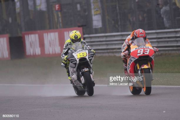 Marc Marquez of Spain and Repsol Honda Team leads Alvaro Bautista of Spain and PullBear Aspar Team during the MotoGP Netherlands Qualifying on June...